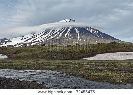 Kamchatka landscape: mountain creek and Oval Zimina Volcano