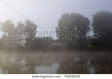 morning fog in loire river, france