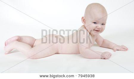 lying naked baby