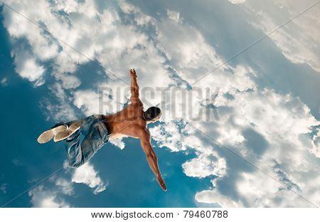 Jump man under sky