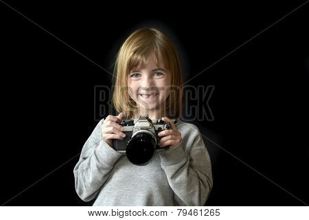Detail portrait of young girl photographer holding old camera shooting photographs