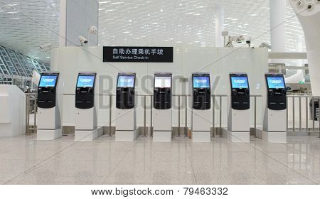 SHENZHEN - APRIL 16: self check-in kiosks on April 16, 2014 in Shenzhen, China. Shenzhen Bao'an International Airport is located near Huangtian and Fuyong villages in Bao'an District, Shenzhen