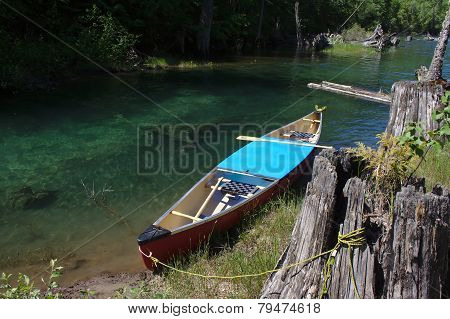 Canoe tethered on a Lake Shore