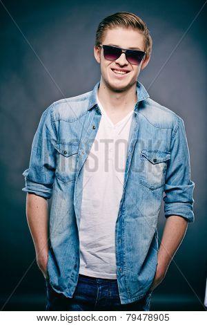 Portrait of a fashionable man in denim jacket