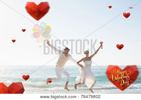 Happy valentines day against newlyweds having fun holding balloons