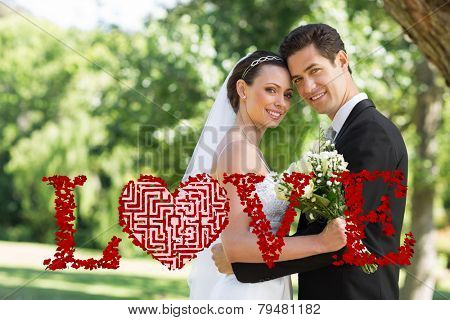 Maze heart against loving newly wed couple in garden