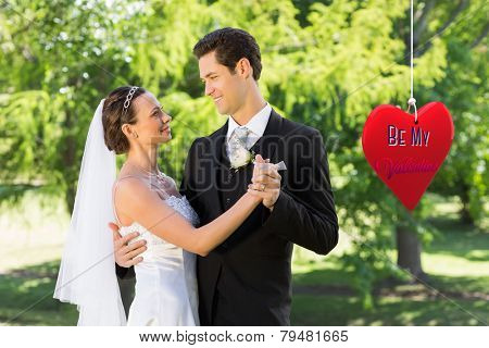 Couple dancing on wedding day against be my valentine