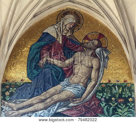 VIENNA, AUSTRIA - OCTOBER 10: Mosaic of pieta from main portal of gothic church Maria am Gestade in Vienna, Austria on October 10, 2014.