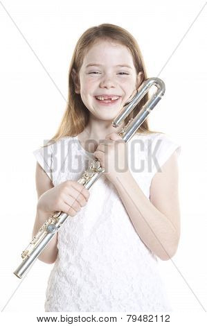 Young Red Haired Girl Holds Flute In Studio
