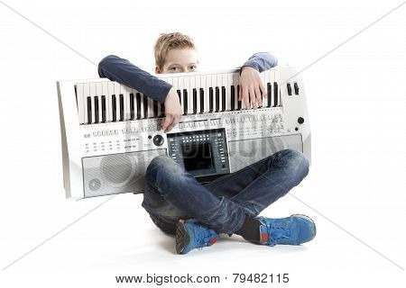 Teenage Boy With Keyboard In Studio