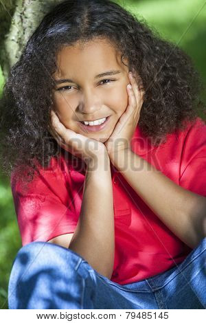 Portrait of a beautiful young smiling happy mixed race interracial girl wearing jeans and polo shirt, shot outside in summer sunshine