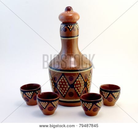ceramic bottle with small ceramic cups