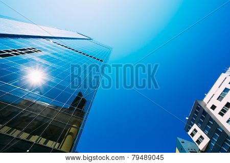 Blue Skyscrapers Background. Modern Architecture In Estonian Cap