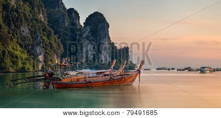 sunset with colorful sky and boat on the beach