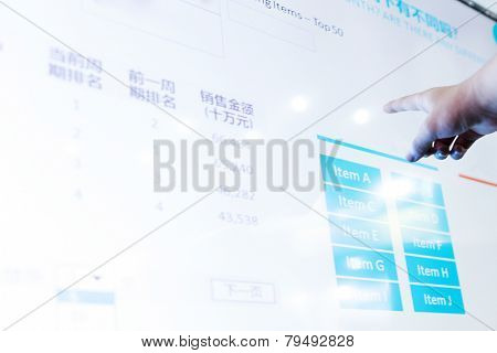 modern business data touch screen,the chinese words are business details like sale,profit etc.Chinese words with blue background on screen is  sales statistic menu to select the category