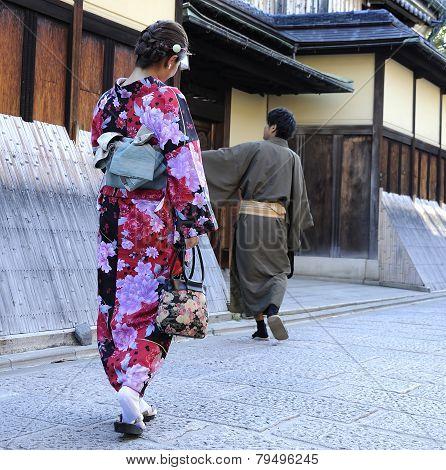 Geisha Walking With Man