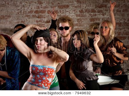 Woman Dancing With Friends At Disco Party