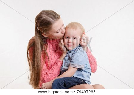 Young Mother Kissing Her Son Three Years