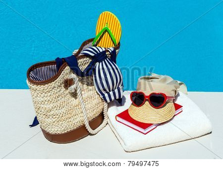 utensils for a nice relaxing vacation day lying next to a swimming pool. relaxation on vacation.