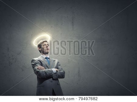 Young saint businessman with halo above head