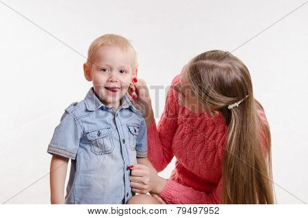 Mom Playfully Took His Son By The Ear