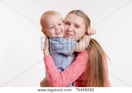 The Three-year Boy Hugging His Mother