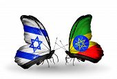 foto of ethiopia  - Two butterflies with flags on wings as symbol of relations Israel and Ethiopia - JPG