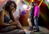 image of envy  - single black woman jealous of interracial couple on dancefloor - JPG