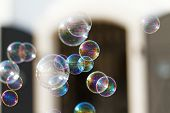 stock photo of blowers  - The rainbow bubbles from the bubble blower