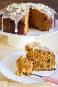 stock photo of icing  - Carrot cake with icing and almond slices  - JPG