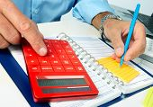 foto of accounting  - Hands of accountant business man with calculator - JPG
