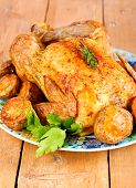 pic of roast chicken  - Roast chicken and roast potatoes on plate - JPG