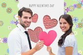 picture of girly  - Pretty brunette giving boyfriend her heart against digitally generated girly floral design - JPG