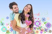 picture of girly  - Happy casual couple smiling and hugging against digitally generated girly floral design - JPG