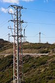 picture of tarifa  - Green hills with electricity poles and wind turbines - JPG