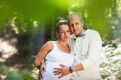 image of beatitudes  - Picture of a happy pregnant couple taken between the leaves of a tree - JPG