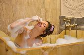 image of bubble-bath  - young pretty woman taking a bubble bath - JPG