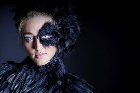 foto of azazel  - portrait of sexy woman with black feather half mask for Venice desire concept - JPG