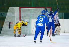 foto of dynamo  - MOSCOW - DECEMBER 12 2014: Sveshnikov M. (66) scores Estbloom J. (4) fall down during the Russian bandy league game Dynamo Moscow vs SKA Neftyanik in sport palace Krilatskoe Moscow Russia. Dynamo won 9:1