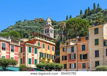 Belfry among typical colorful houses of Portofino - popular resort on Italian Riviera.