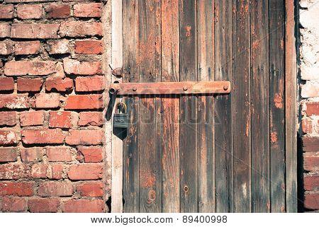 Old Wooden Door With A Padlock