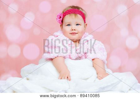 Portrait of a sweet baby girl. Newborn. Happy childhood.