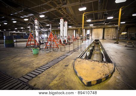Dirty, Oily Bus Garage Inspection Pit