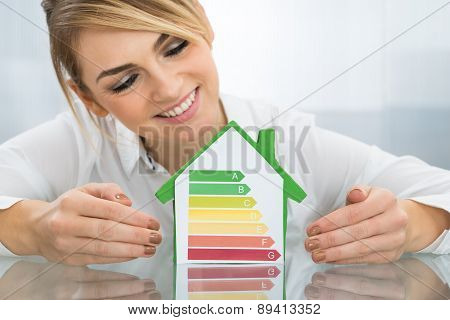 Businesswoman With Energy Efficient Chart House Model