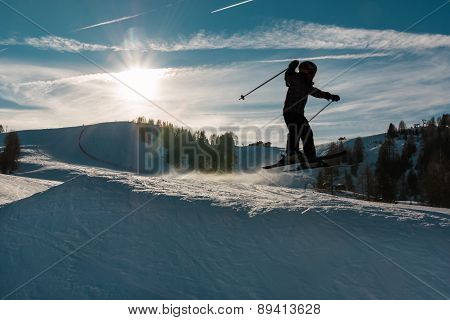 Little Skier Performs Jump In The Snow