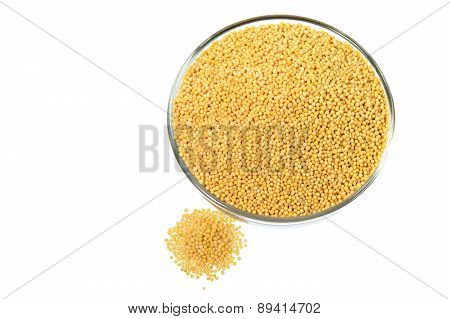 Yellow mustard seeds with heap