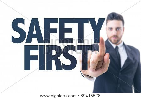 Business man pointing the text: Safety First