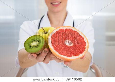 Dietician Holding Fresh Sliced Fruits