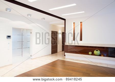 Bright Corridor With Fireplace