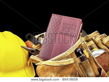 Bible In Construction Belt And Tools On Black Background